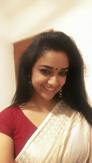 Black Hair Casual Clothing Close-up Front View Head And Shoulders Headshot Home Interior Indoors  Keerthi Suresh Leisure Activity Lifestyles Long Hair Looking At Camera Person Portrait Revathi Suresh Smiling Young Adult Young Women