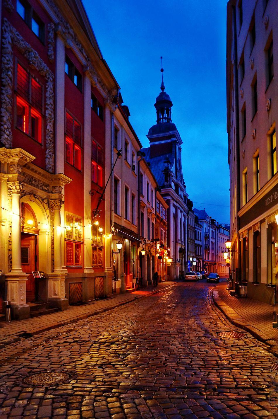 Riga Architecture Travel Destinations Cityscape Street Illuminated City Vacations Outdoors Building Exterior Night No People Sky Urban Skyline Riga Latvia City Cafe Place Setting Rigaplaces Window