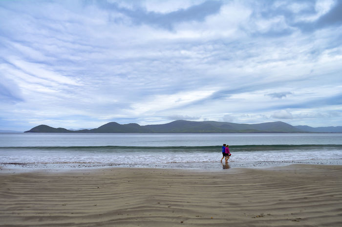 Beach Cloud Cloudy Coastline Day Idyllic Ireland Kerry Mountain Nature Outdoors People Ring Of Kerry Rippled Sand Scenics Sea Shore Sky Tourism Tourist Tranquility Vacations Walkers Water