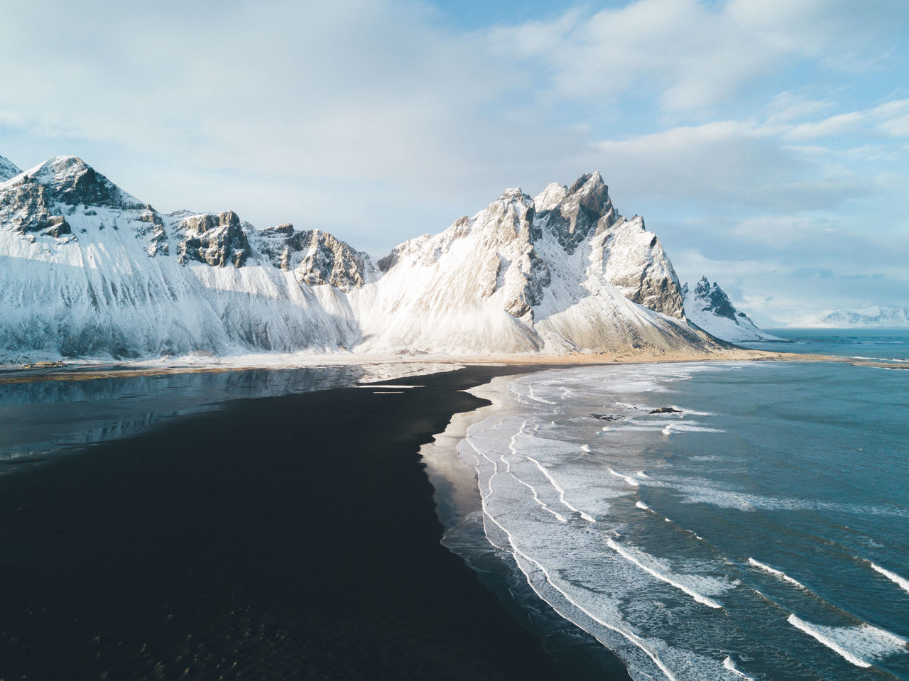 Stokksnes black sand beach in Iceland at sunset Beauty In Nature Day Glacial Glacier Ice Iceberg Landscape Mountain Nature No People Outdoors Sea Sky Snow Water Fresh On Market 2017