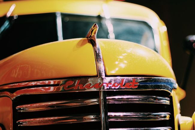 yellow chevy car Chevy Chvy Classic Car Classic Cars Close-up Focus On Foreground Medium Group Of Objects No People Old Buildings Something Yellow Yellow Yellow Cheese