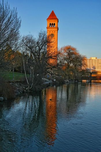 Clock Tower Architecture Bare Tree Beauty In Nature Bell Tower Building Exterior Built Structure Clock Clock Tower Day Lighthouse Nature No People Outdoors Reflection Sky Spokane Washington Tower Tree Water