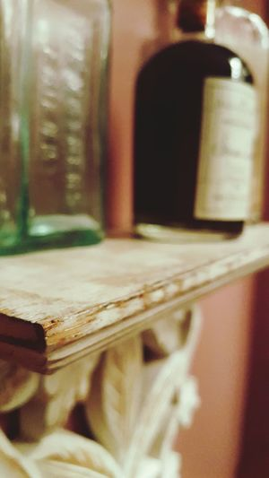 Selective Focus Paint Decay Distressed Wood Apothacary Old Fashion Bottle Shelf