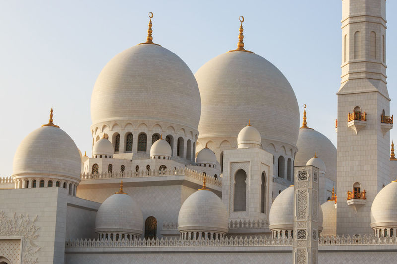 Abu Dhabi, United Arab Emirates - October 10,2014: Sheikh Zayed Grand Mosque at sunset Abu Dhabi Arabic Arch Architecture Building Exterior Built Structure City Clear Sky Culture Dome Façade Faith Famous Place International Landmark Islam Monument People Religion Sheik Zayed Mosque Taj Mahal Tourism Travel Travel Destinations United Arab Emirates White Mosque