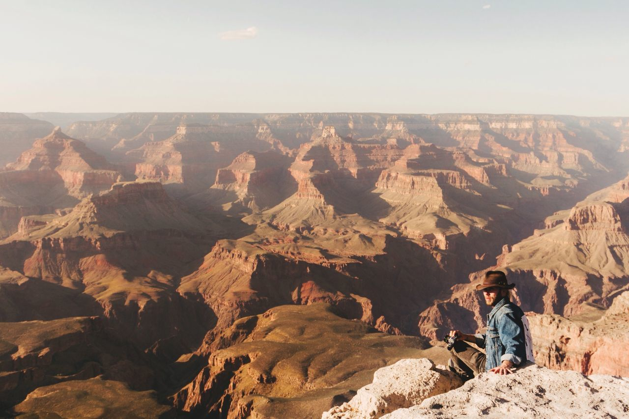 Golden hour at the Grand Canyon, anything better? One Person Real People Nature Physical Geography Rock - Object Mountain Beauty In Nature Scenics Leisure Activity Landscape Outdoors Day Standing Sitting Women Young Adult Grand Canyon Sunset Orange Golden Hour Canyon Hiking Outdoors Photograpghy  Monument Travel