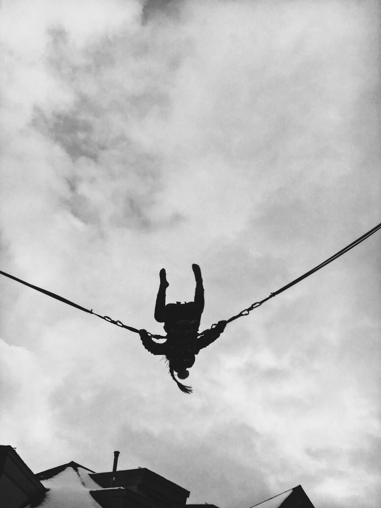 Low Angle View Sky Real People Day Lifestyles Full Length Outdoors One Person Leisure Activity Skill  Cloud - Sky Cold Temperature Black & White Jumping Mid-air Low Angle View Adventure Performance Swing People