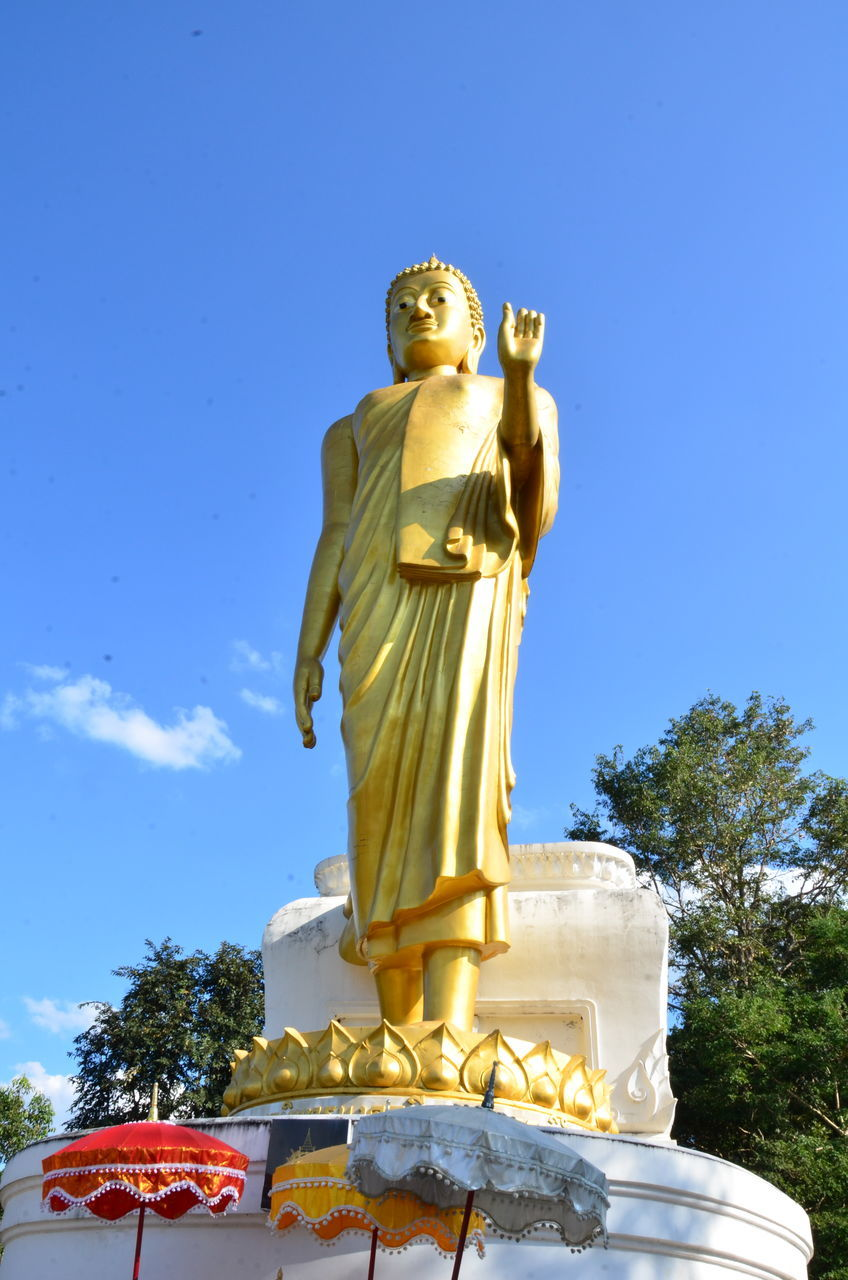 statue, human representation, sculpture, male likeness, low angle view, art and craft, gold colored, religion, spirituality, no people, day, golden color, outdoors, sky