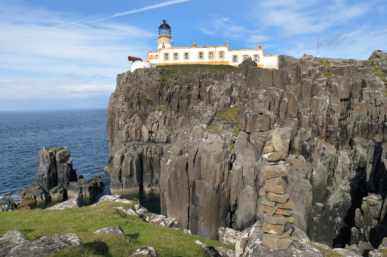 Neist point lighthouse on the Isle of Skye. In the foreground is a cairn built by visitors to the point. Blue Cliff Cloud Coastline Lighthouse Lighthouse No People Rock Scotland Sea Sky Skye Water
