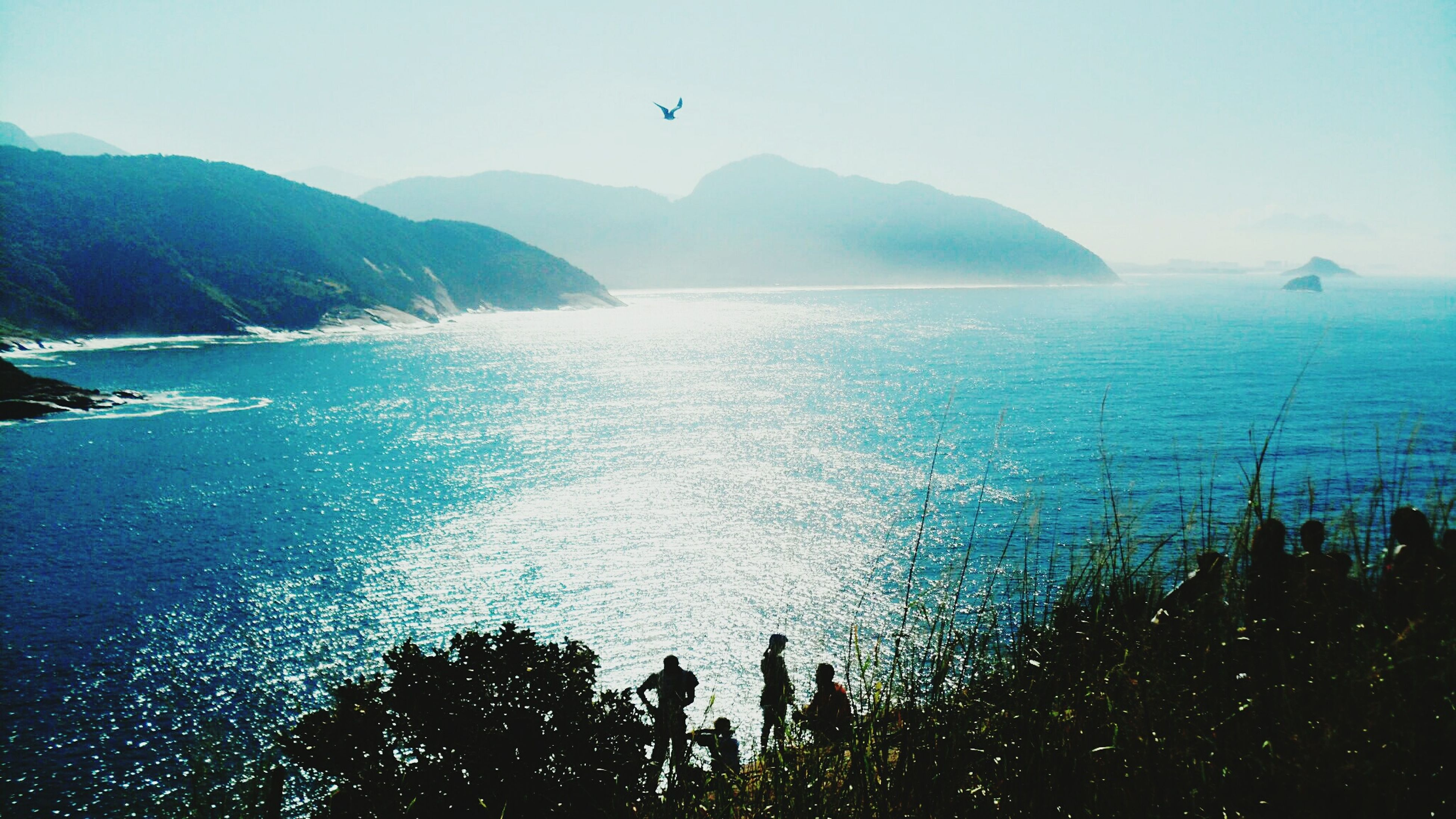 sea, water, scenics, tranquil scene, mountain, beauty in nature, tranquility, horizon over water, blue, nature, clear sky, sky, idyllic, coastline, seascape, outdoors, mountain range, no people, day, ocean