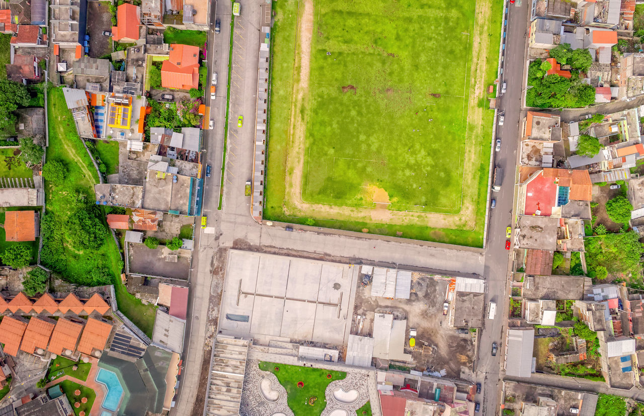 Cityscape View Of Banos De Agua Santa, Latin American Town, Tungurahua Province, South America Aerial Aerial Photography Aerial Shot Aerial View Andes Architecture Building Exterior City Cityscape Crowded Day Drone  Dronephotography Droneshot High Angle View Houses Mountain View Multi Colored Neighborhood No People Outdoors Roofs Stadium Streetphotography Travel Destinations