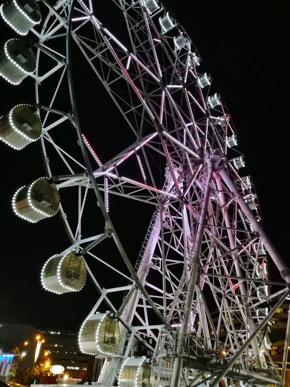 night, amusement park, low angle view, arts culture and entertainment, amusement park ride, ferris wheel, big wheel, illuminated, sky, no people, built structure, outdoors