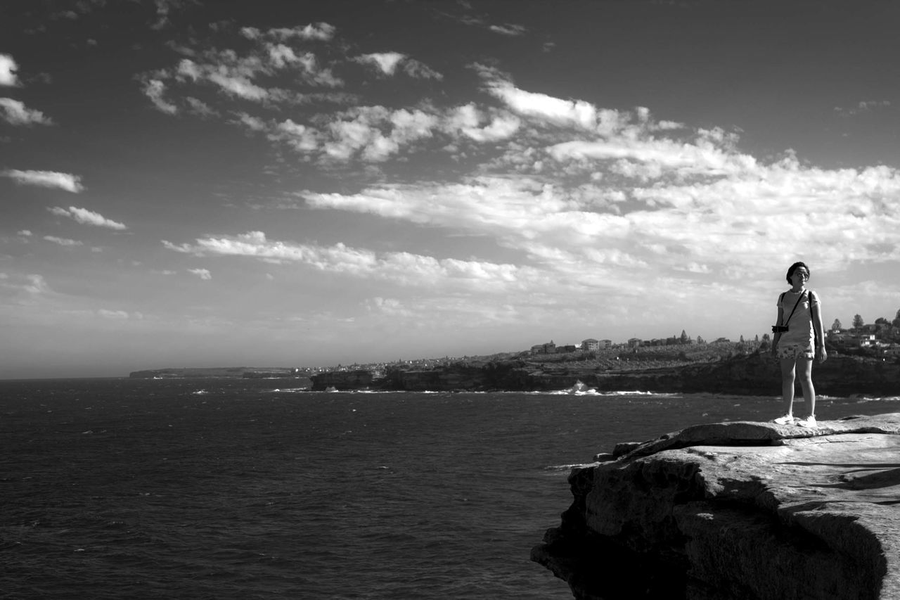 Standing alone at the edge of the cliff Sea Water Beach Vacations Outdoors Cloud - Sky Sky Nautical Vessel One Person People Nature Day Adults Only Adult Black And White Tranquil Scene Australian Landscape Black And White Photography