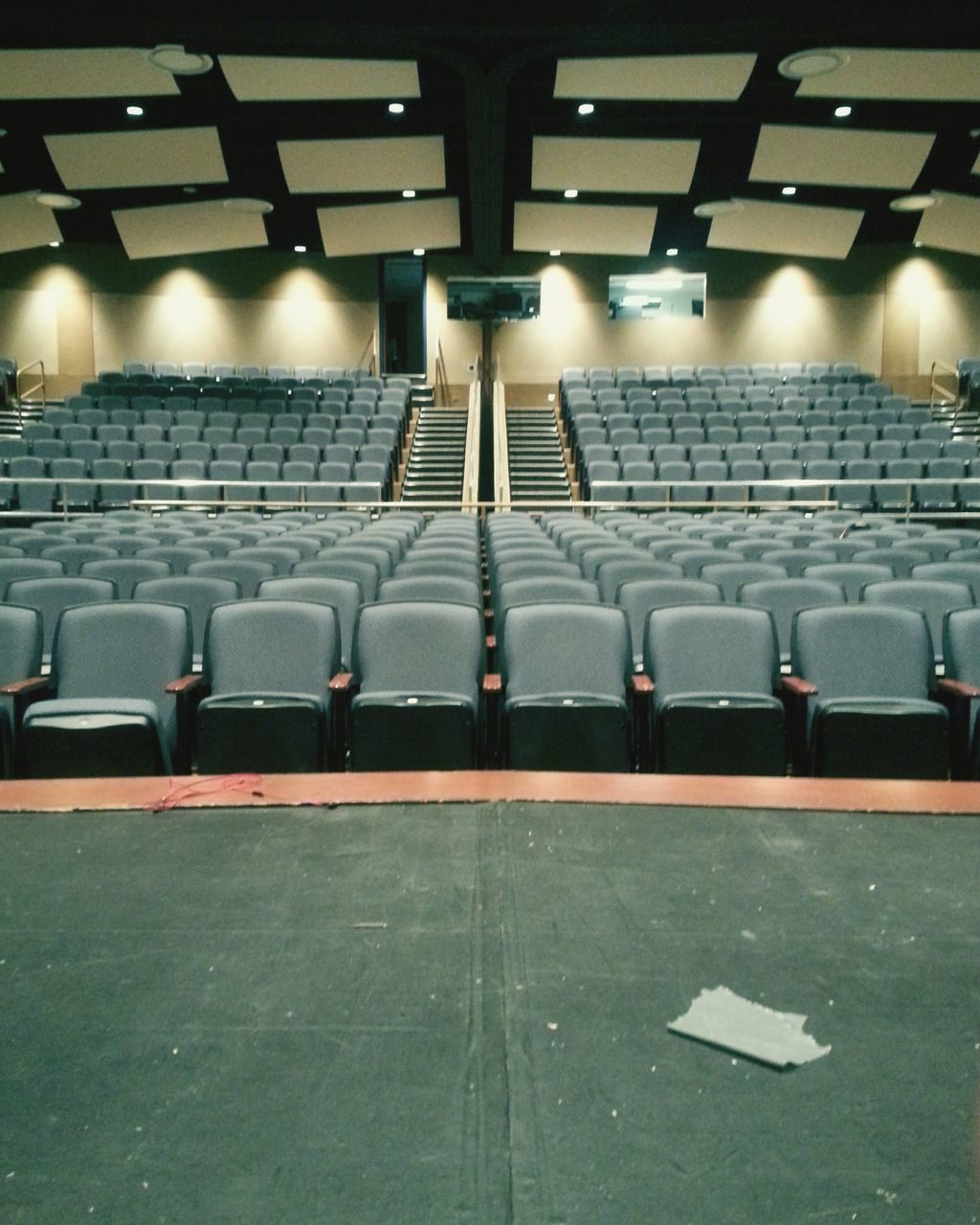 in a row, seat, chair, empty, auditorium, indoors, absence, arts culture and entertainment, audience, illuminated, lecture hall, film industry, day, people