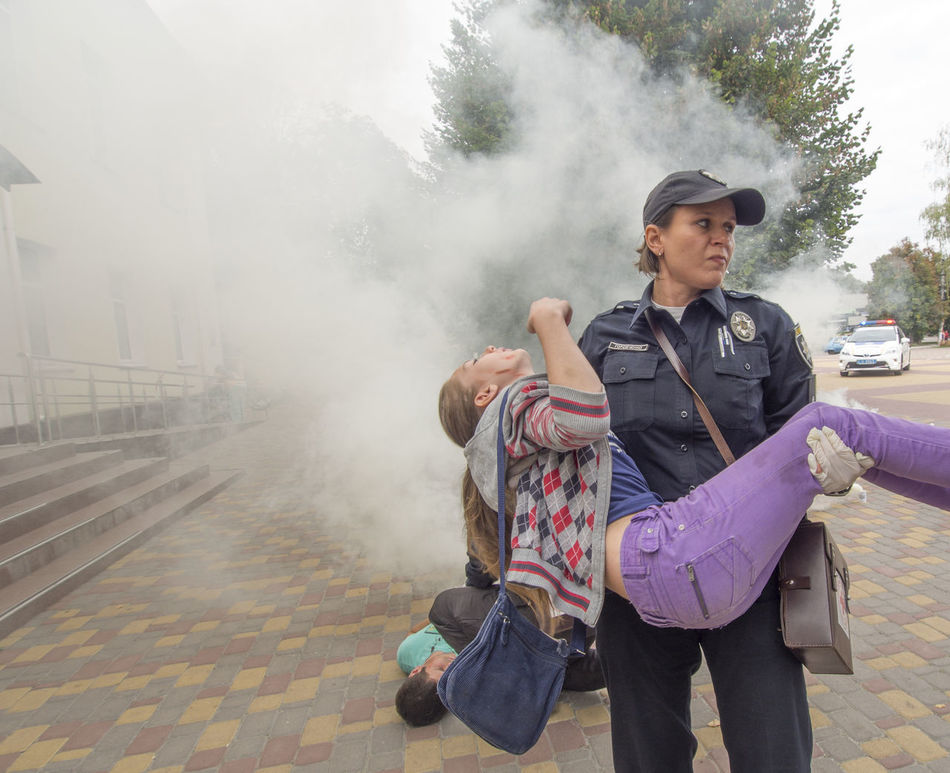 Red Cross held on Saturday, September 10, 2016, in Borispol, Ukraine training to rescue the wounded, the victims of the terrorist attacks. Attacks Casual Clothing Day Doctor  Fog Foggy Footpath Holding Memories Police Red Cross Rescue Smoke - Physical Structure Terrorist Tourism Training Travel Destinations Vacations Victims Warm Clothing Wounded