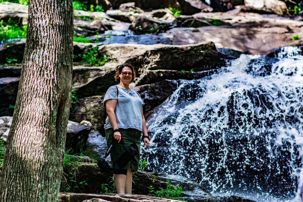 Adult Adults Only Beauty In Nature Casual Clothing Day Forest Full Length Glendale Falls Middlefield, MA Moss Motion Nature One Person One Woman Only Outdoors People Power In Nature Standing Tree Tree Trunk Water Waterfall Young Adult Young Women