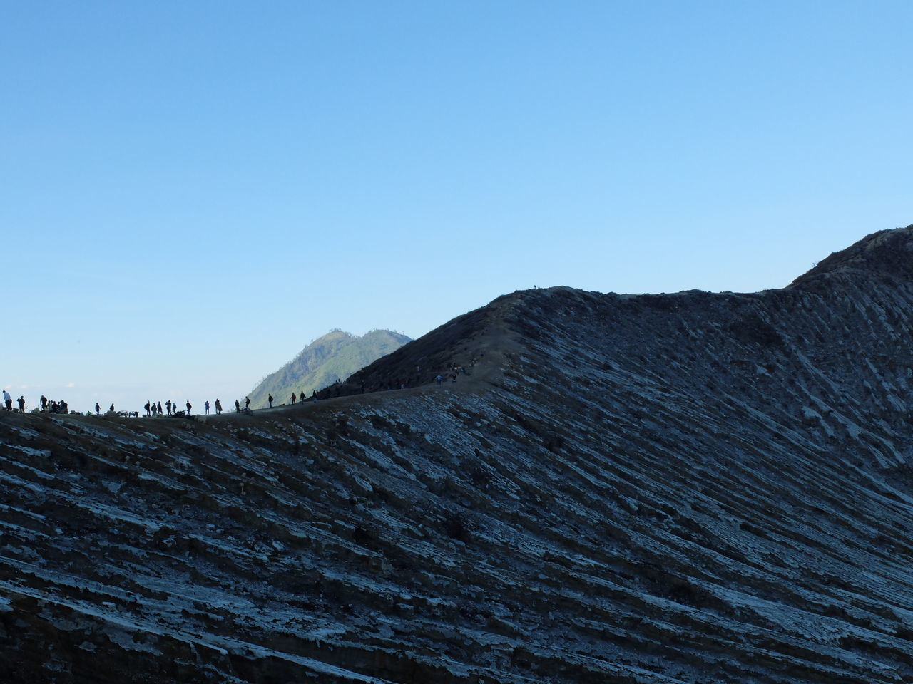 Trekking at sunrise on the Ijen Volcano, Indonesia. Beauty In Nature Day Geology Ijen Ijen Crater INDONESIA Kawah Ijen Landscape Mountain Nature No People Outdoors Sky Sunrise Tranquil Scene Trek Trekking Volcano
