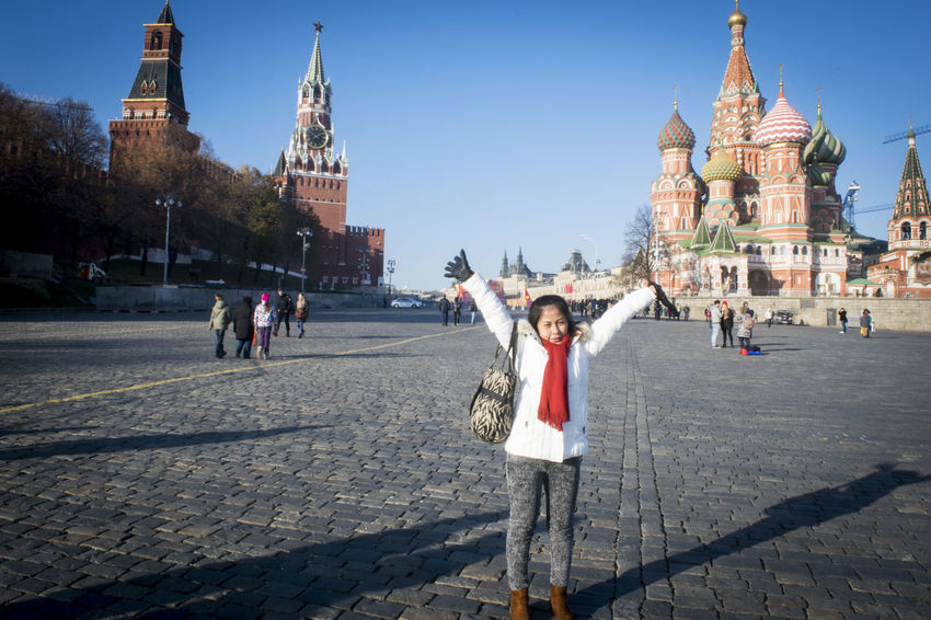 Architecture Asian Girl Building Exterior Built Structure Capital Cities  Church City City Life Cultures Day Famous Place History Leisure Activity Lifestyles Mixed Age Range Outdoors Place Of Worship Red Square Moscow Religion Sky Spirituality St Basil's Cathedral Tourism Tourist Travel Destinations