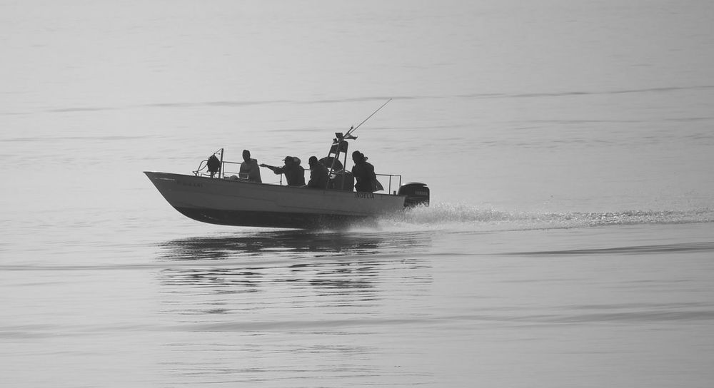 Nautical Vessel Sea Vacations Travel Fishing Social Issues People Adult Adventure Business Finance And Industry Fisherman Men Leisure Activity Occupation Day Travel Destinations Outdoors Nature Sailing Horizon Over Water Taking Photos Motion Water Popular Photos Popular Water