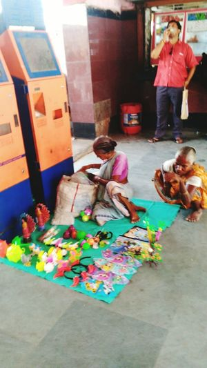 Two Older Woman Selling Toys