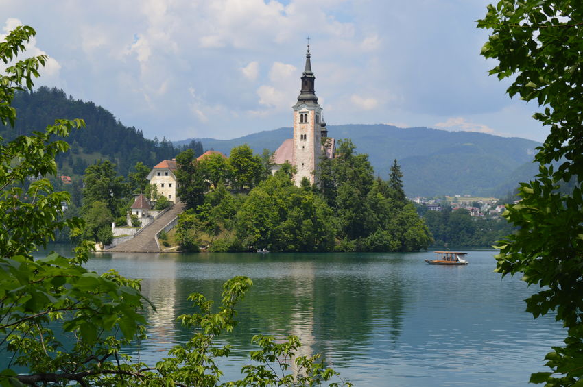 Reflection_collection Lake Water Reflections Slovenia ❤ Pallette Tranquility Colours Of Nature Ripples In The Water Landscape Beauty In Nature Outdoors Bled, Slovenia Colours Of Nature Colour Palette Tower Spirituality Religion Waterfront Architecture Tree Water Mountain Sky History Growth