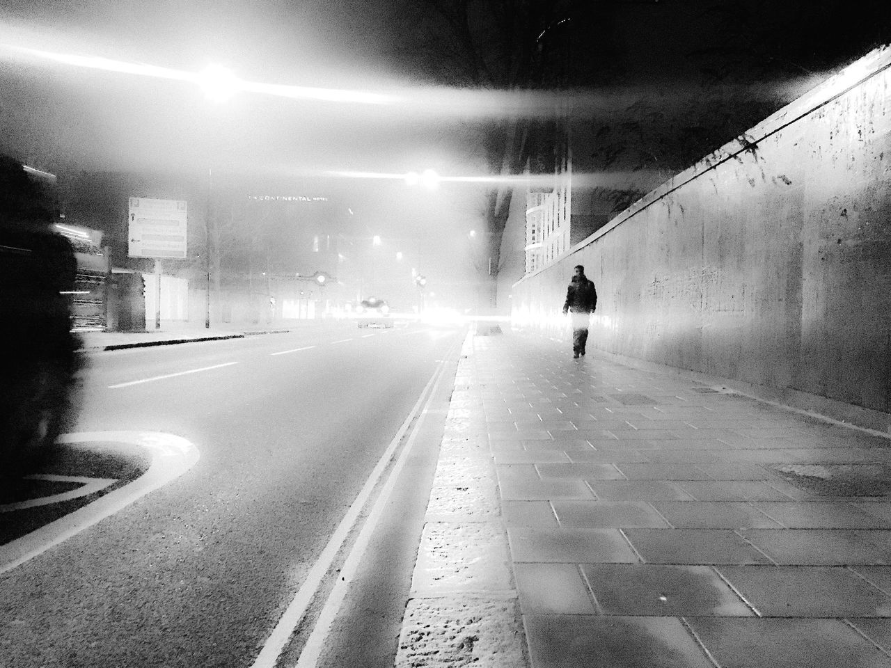 One Man Only Illuminated Walking One Person Fresh On Eyeem  The Week Of Eyeem Black And White Photography Atmospheric Mood Artistic Vanishing Point Abstract EyeEm Best Shots Streetphotography EyeEm Best Shots - The Streets Reflection Mysterious Night Urban Exploration Street Scene