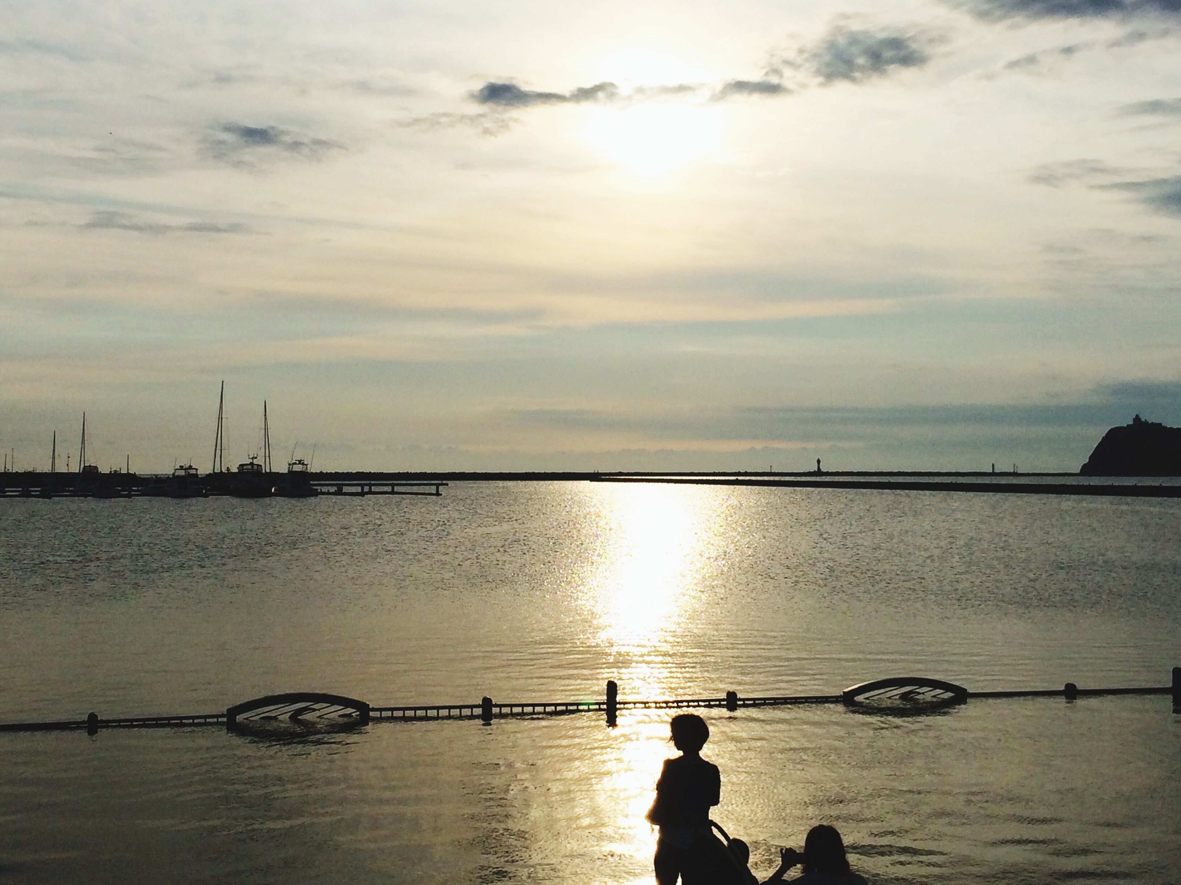 water, silhouette, sunset, sky, sea, sun, transportation, nautical vessel, tranquility, mode of transport, scenics, tranquil scene, reflection, nature, sunlight, beauty in nature, lake, men, bicycle