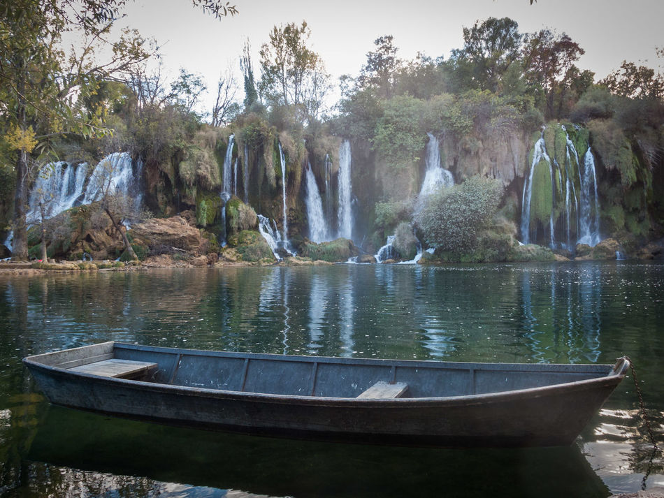 Water Reflection Nature Waterfall Famous Place Bosnia And Herzegovina Kravice Kravica, Bosnia & Herzegovina Boat Lonely Tourism Tourist Attraction  Tourist Tree Outdoors Day Landscape