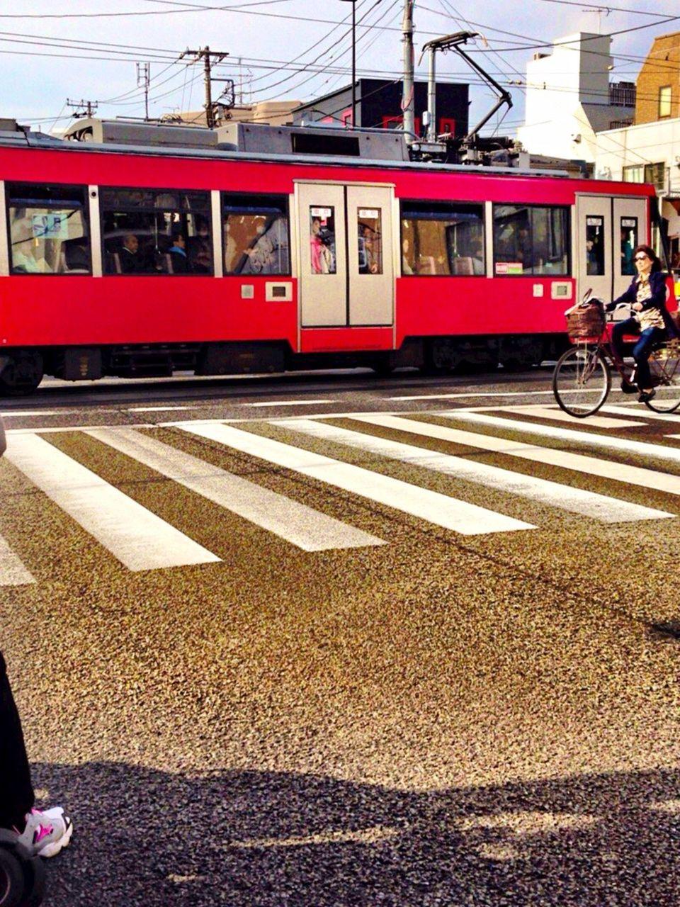 transportation, mode of transport, public transportation, men, real people, day, train - vehicle, outdoors, women, city, sky, people