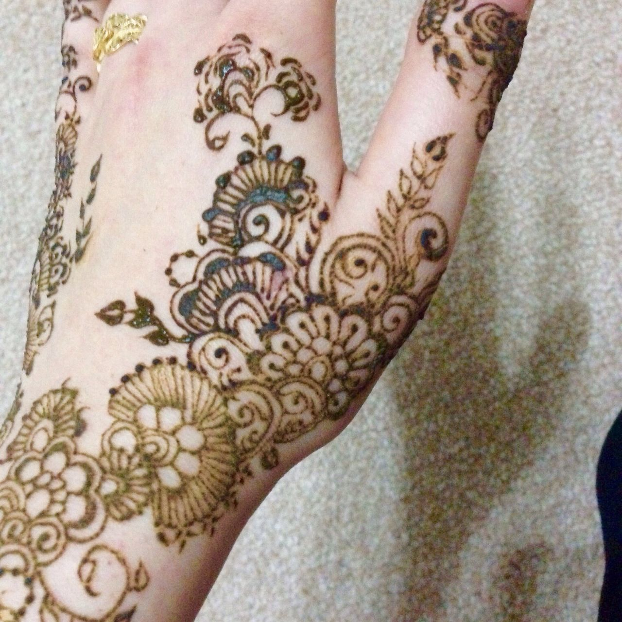 tattoo, henna tattoo, floral pattern, design, art and craft, one person, human body part, human hand, only women, one woman only, close-up, real people, high angle view, pattern, indoors, fashion, women, midsection, adult, adults only, flower, people, low section, one young woman only, day