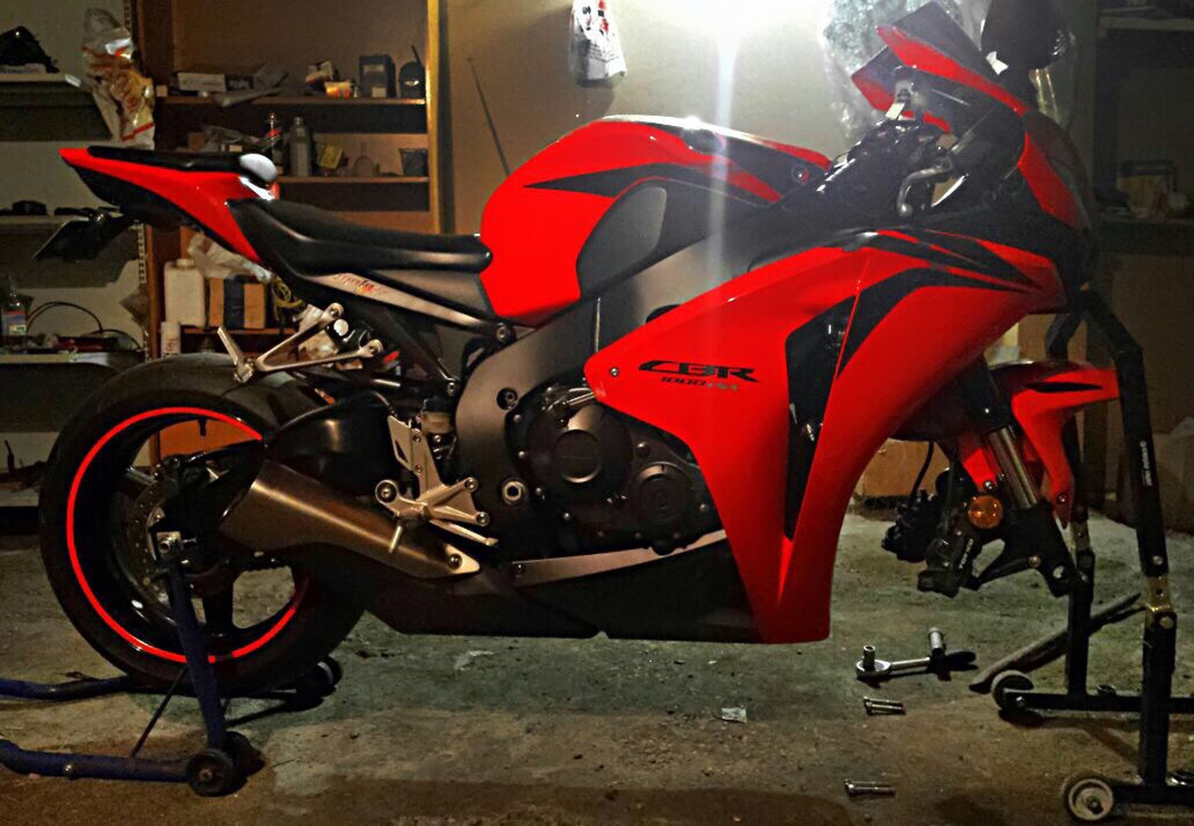 red, motorcycle, competitive sport, sports race, shiny, no people, motorsport, outdoors, racecar, day