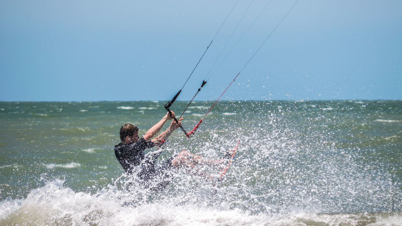 Adrenaline Beauty In Nature Clear Sky Enjoyment Holding Horizon Over Water Kitesurfing Leisure Activity Lifestyles Men Nature Person Sea Sky Vacations Water Waterfront Wave Blue Wave