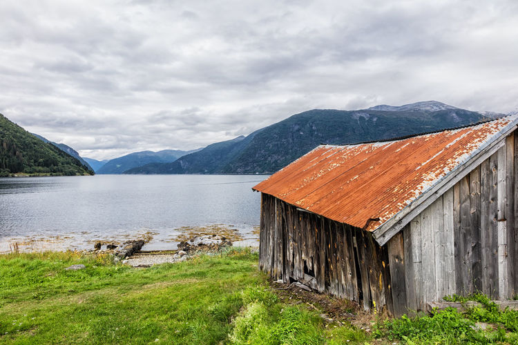 Boathouse on the Storfjord in Norway. Architecture Beauty In Nature Boathouse Building Exterior Day Fjord Holiday Landing Stage Landscape Mountain Mountain Range Nature No People Norway Outdoors Pier Sky Storfjord Tourism Travel Vacation Water