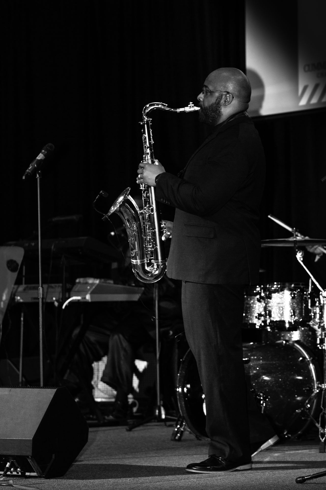 Adult Adults Only Arts Culture And Entertainment Full Length Indoors  Jazz Music Mature Men Men Microphone Music Musical Instrument Musician One Man Only One Person One Senior Man Only Only Men People Performance Piano Playing Saxophone Saxophonist Skill  Stage - Performance Space Trumpet