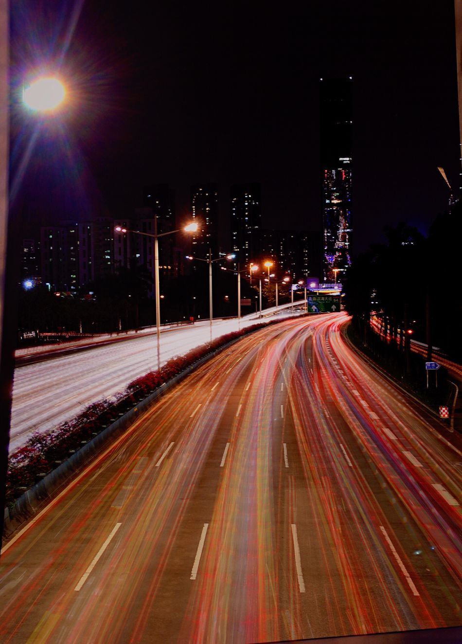 Speed Illuminated Light Trail Motion Night Long Exposure High Street Building Exterior Blurred Motion Street Light Street Outdoors Transportation Architecture No People Urban Scene Road City Sky