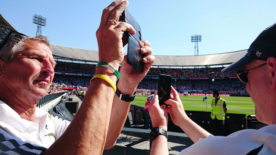 Feyenoord in a Well Deserved Third Place in the Dutch Eredivisie ( Premier League Soccer) Supporters Cheering and Recording the Celebration on Photo and Video on their Mobile Phones. De Kuip Stadium Rotterdam The Street Photographer - 2016 EyeEm Awards The Essence Of Summer Football Fever Internet Addiction Snap A Stranger Adventure Club People Together The Color Of Sport