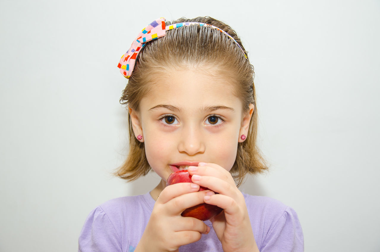 Beautiful stock photos of white background, 4-5 Years, Apple - Fruit, Biting, Caucasian Ethnicity