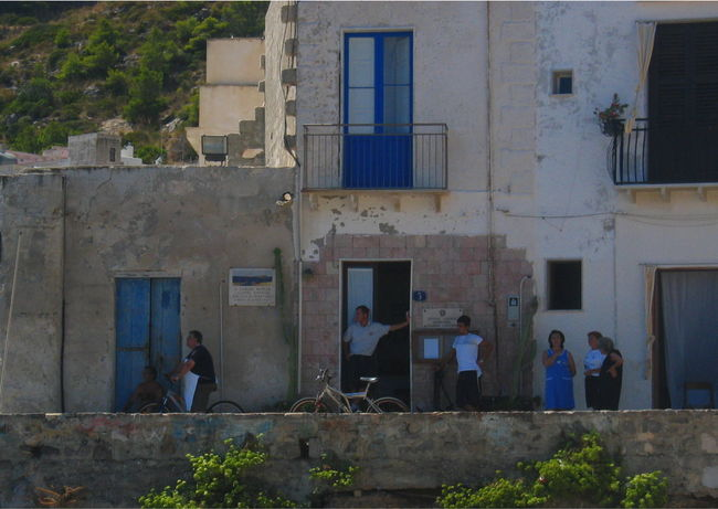 Building Exterior Day House Lifestyles Marettimo Island Men Sicily, Italy Standing Togetherness Waiting For The Ferry