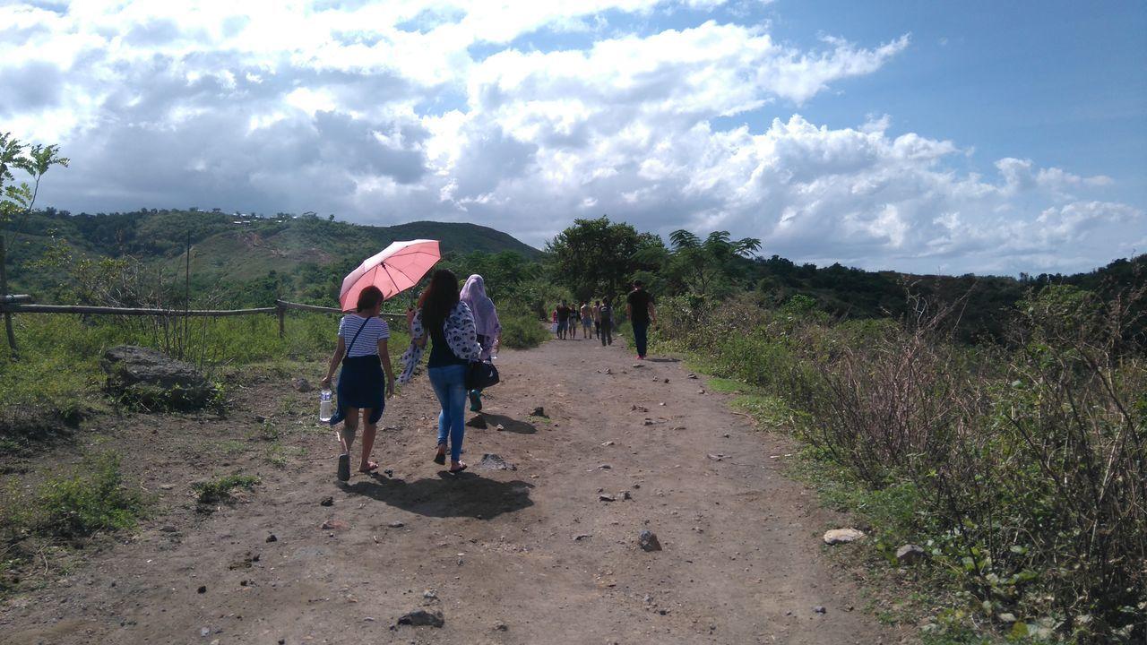 Adventure Buddies Nofilter Noontime  Trekking Clouds Umbrellas Sunnyday