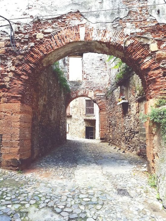 Walking Arch Built Structure Building Exterior Old City Streets Walking Around The City  Red Street Archway Old City Day Architecture Arch Built Structure Building Exterior The Way Forward Day No People Water Outdoors Archway