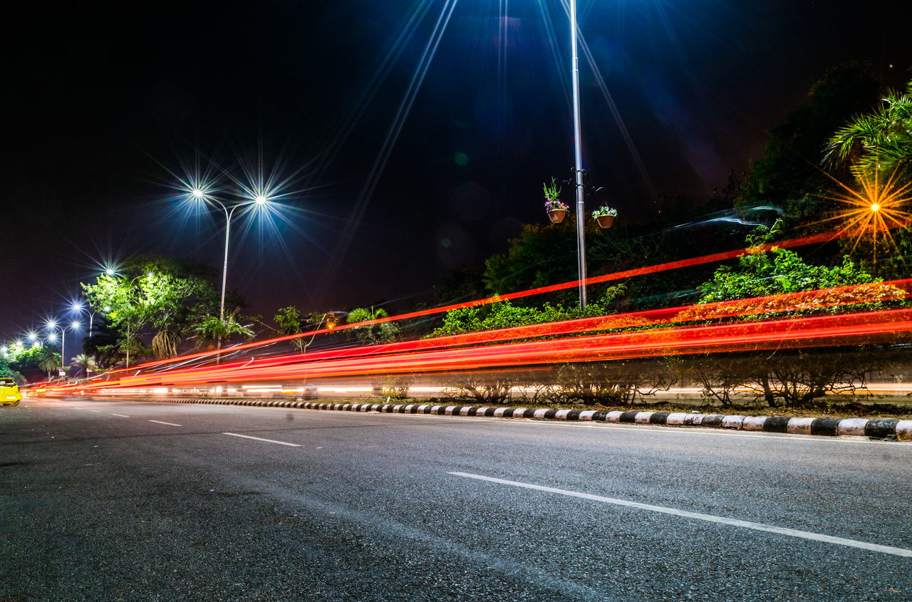 Blurred Motion City Clear Sky Headlight Illuminated Light Trail Lighting Equipment Long Exposure Motion Night No People Outdoors Road Sky Speed Street Light Traffic Urban Road Vehicle Light