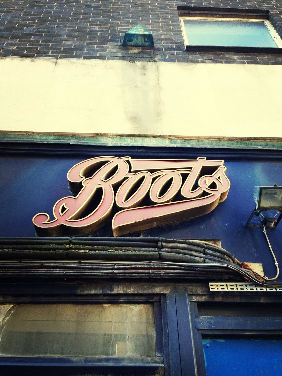 Closed down Boots store. Catching A Bus