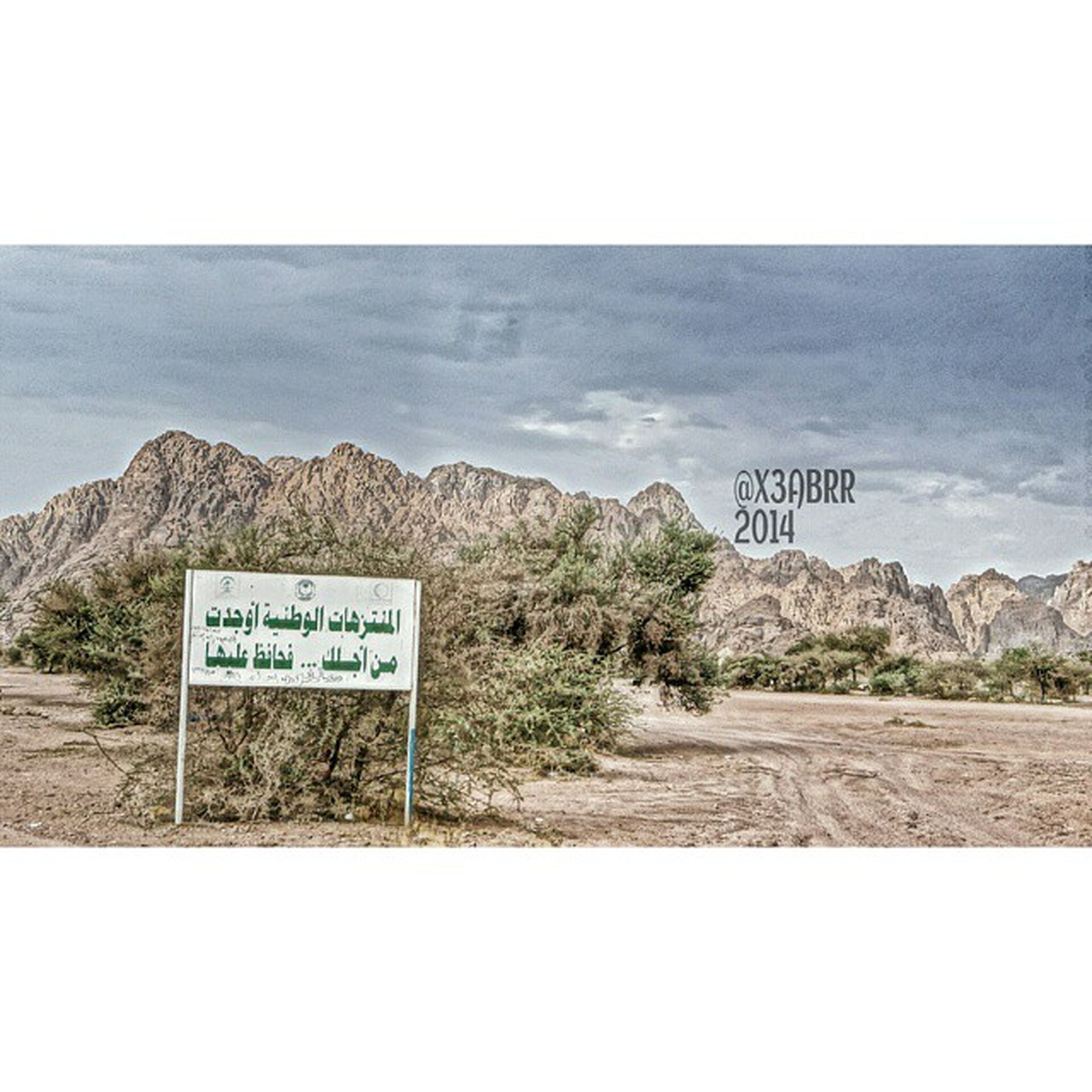 text, western script, communication, information sign, guidance, sign, mountain, sky, tranquil scene, tranquility, road sign, direction, scenics, warning sign, information, nature, non-western script, capital letter, landscape, road