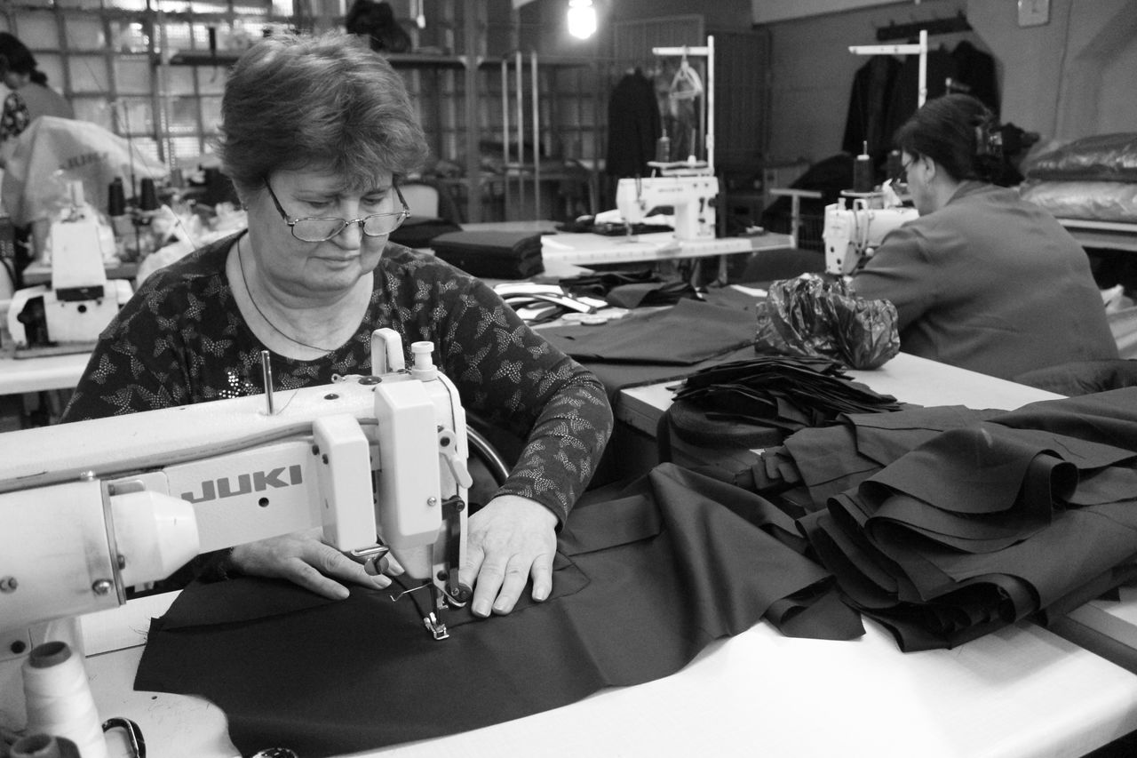 sewing machine, sewing, real people, working, textile industry, occupation, two people, manufacturing equipment, men, women, night, young adult, adult, people