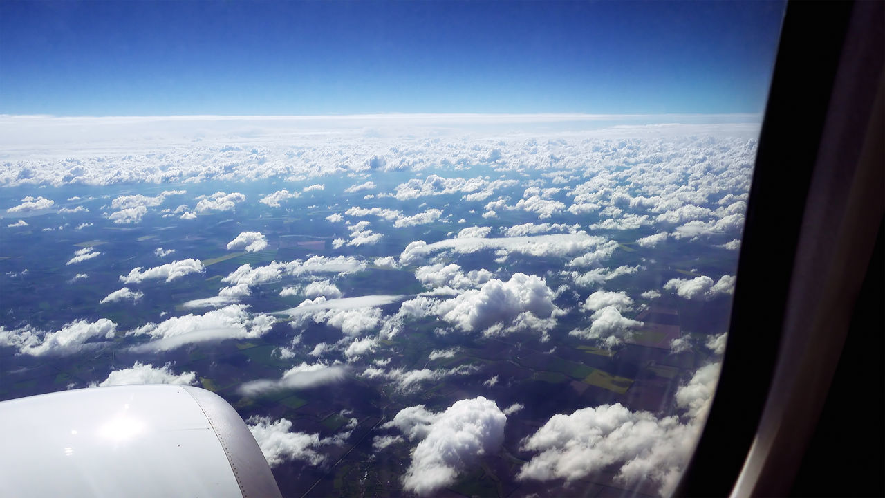transportation, airplane, aerial view, nature, beauty in nature, journey, mode of transport, air vehicle, scenics, vehicle interior, window, flying, sky, travel, vehicle part, day, cloud - sky, airplane wing, blue, no people, tranquil scene, tranquility, mid-air, aircraft wing, landscape, outdoors, the natural world