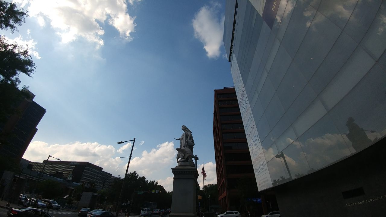 architecture, building exterior, built structure, sky, cloud - sky, city, low angle view, outdoors, day, statue, no people, sculpture