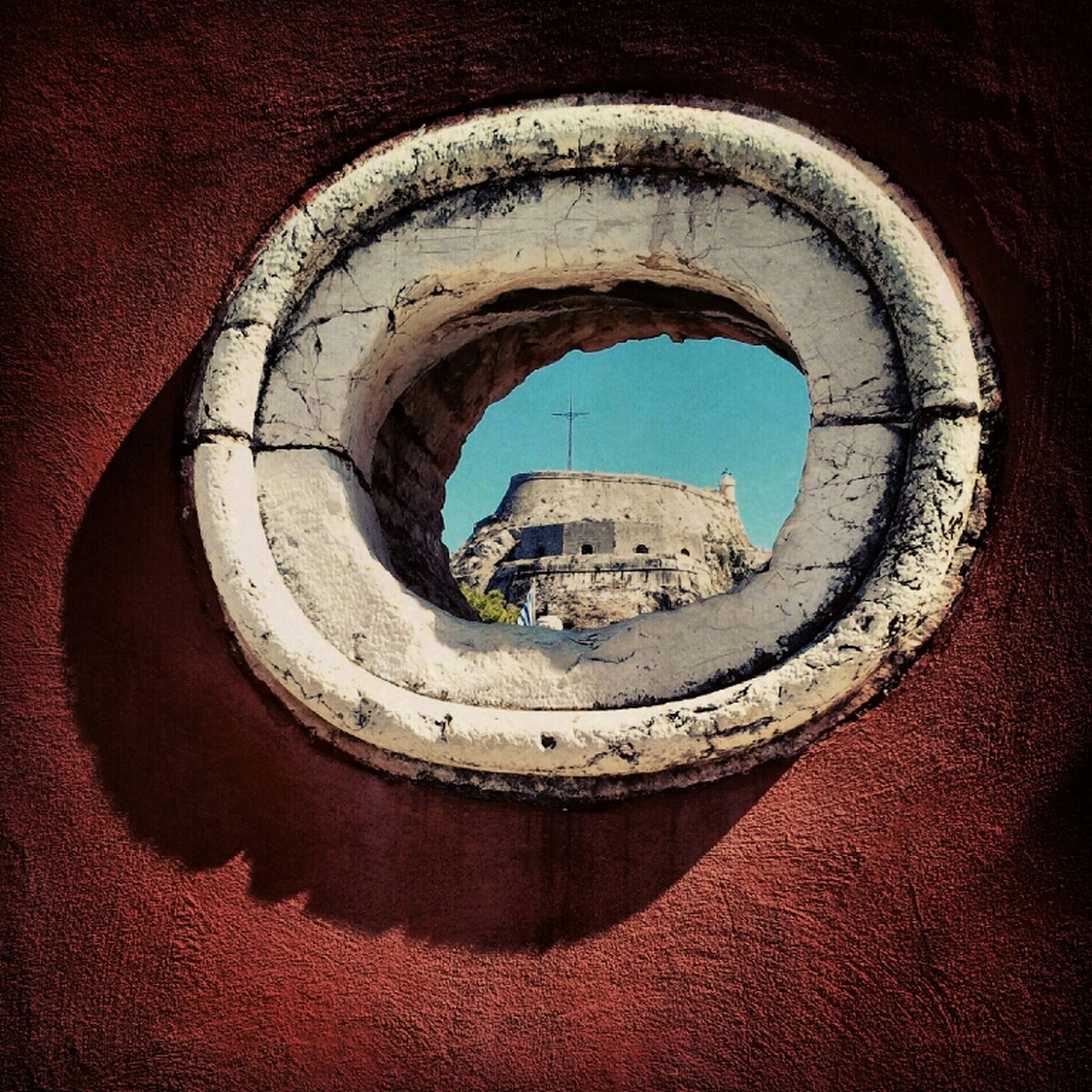 architecture, built structure, circle, building exterior, sky, geometric shape, arch, hole, no people, indoors, close-up, day, window, old, low angle view, blue, weathered, building, wall - building feature