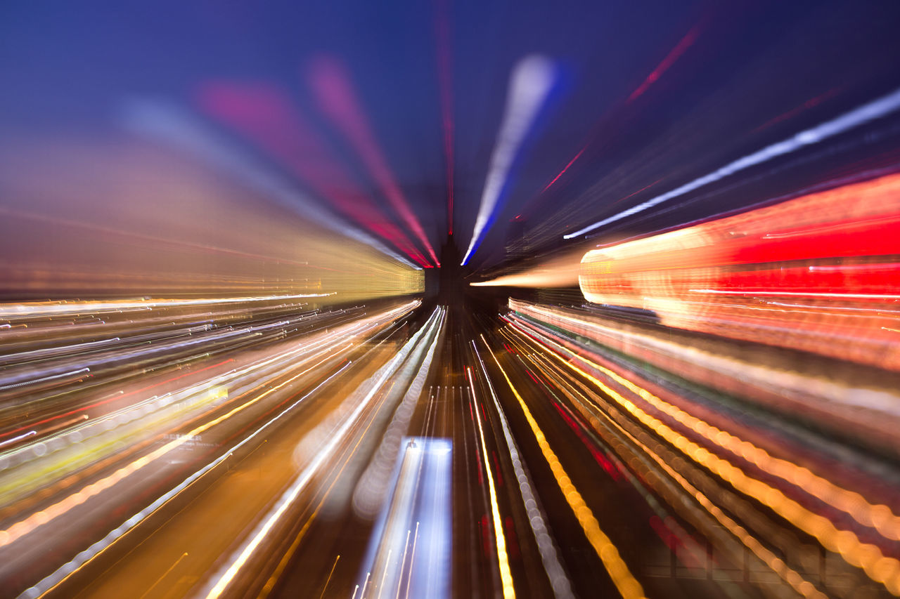 Abstract Activity Backgrounds Blurred Motion Brightly Lit City City Life Cityscape Colors Futuristic Illuminated Light Trail Long Exposure Mode Of Transport Motion Multi Colored Neon Night No People Outdoors Speed Transportation