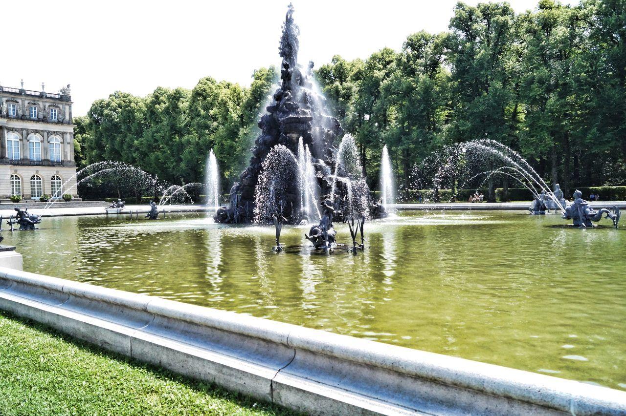 Architecture Fountain Outdoors Sculpture Sky Splashing Statue Water