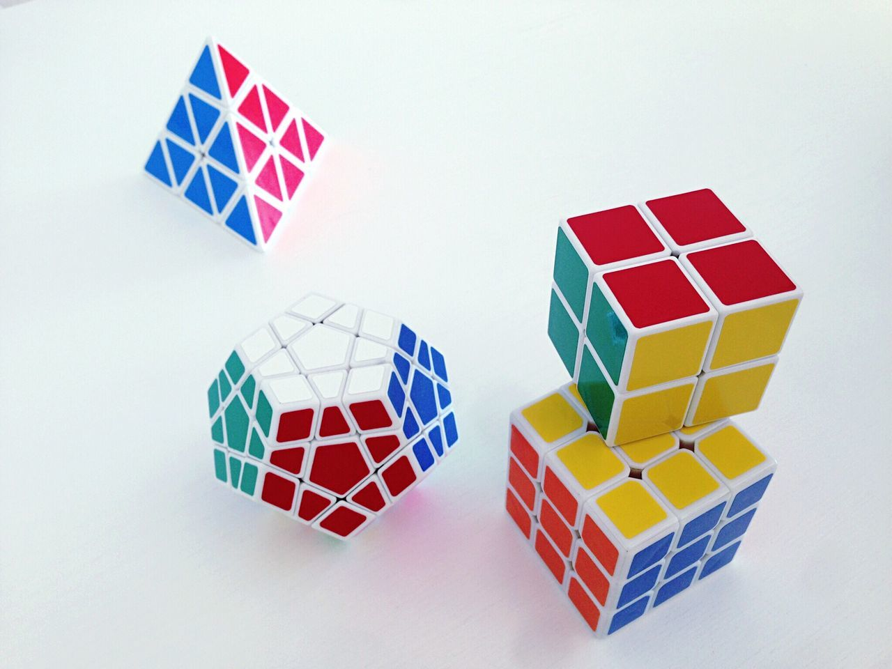 multi colored, shape, geometric shape, white background, still life, puzzle, toy, no people, indoors, balance, toy block, childhood, studio shot, pattern, large group of objects, leisure games, red, close-up, gambling, day