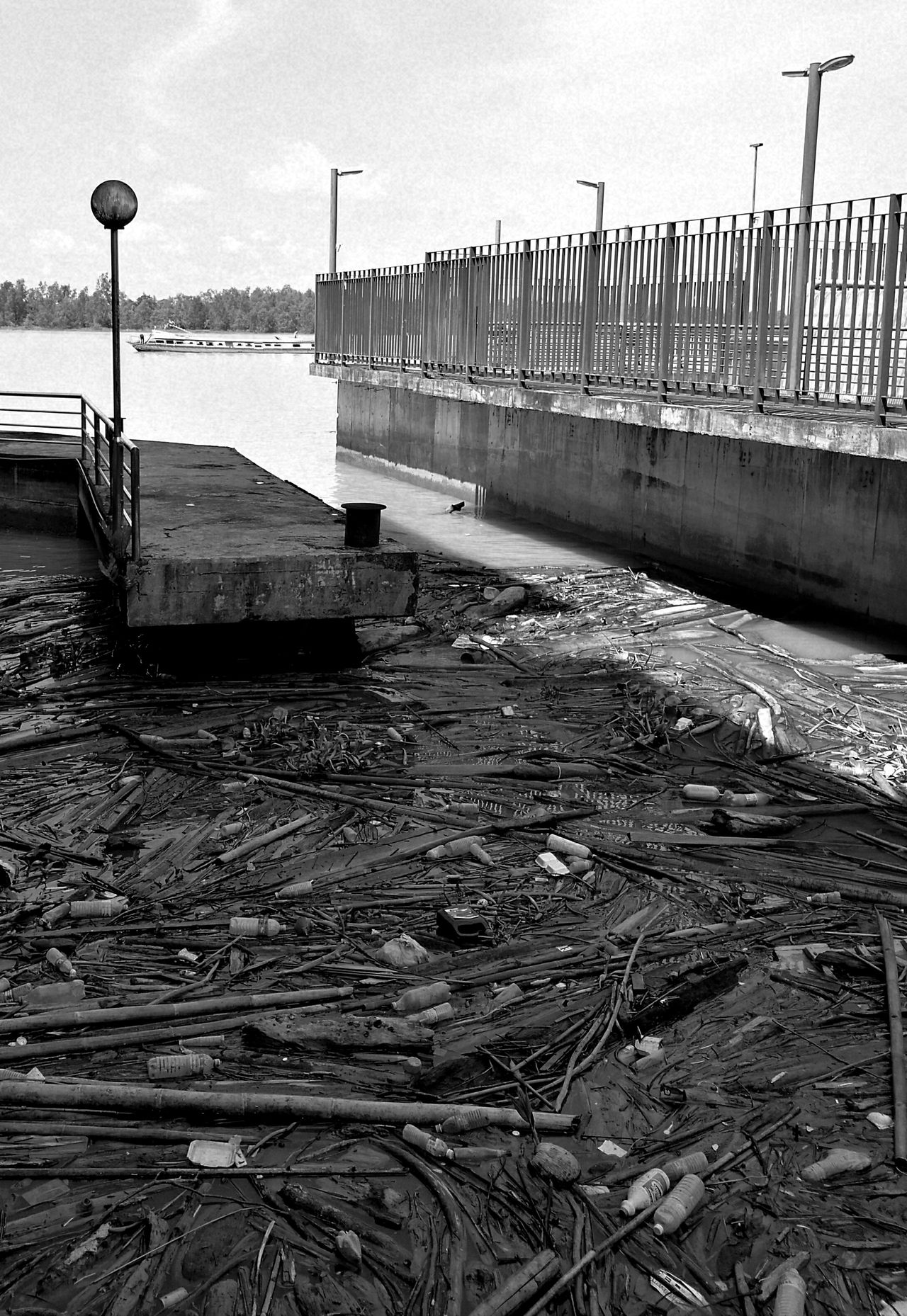 Stop harming our rivers. Pollutions Environmental Issues Environmental Conservation River Love Earth Stop Littering Rubbish Save The Planet Save The River Black And White Photography Waterfront Pier No People